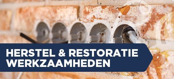 Herstel werkzaamheden en restoratiewerkzaamheden met muur en open stopcontacten.